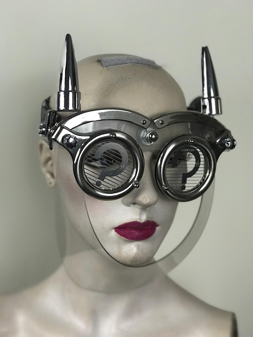 eye wear mask with metal horns perforated metal ocular lens Hi Tek