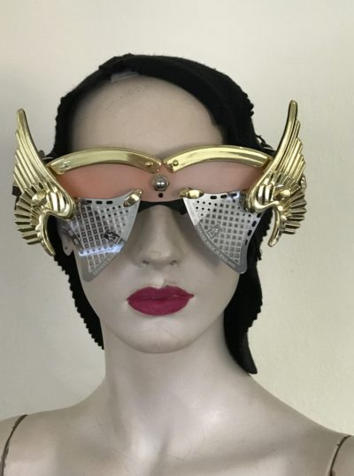 artistic modern steampunk eye wear mask metal wings perforated metal ocular lens Hi Tek pink face