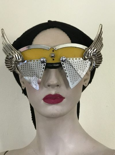 artistic modern steampunk eye wear mask metal wings perforated metal ocular lens Hi Tek yellow face