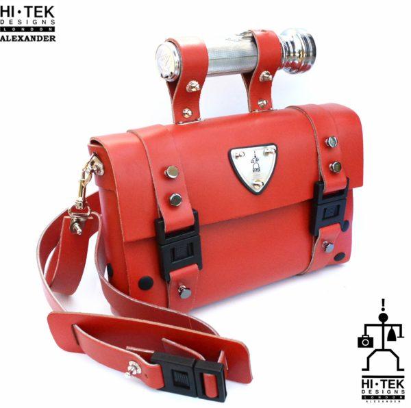 read leather shoulder bag, industrial design torch as handle, statement bag
