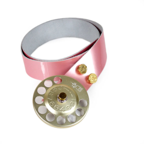 pink shiny leather belt with large round telephone dial buckle unusual statement belt
