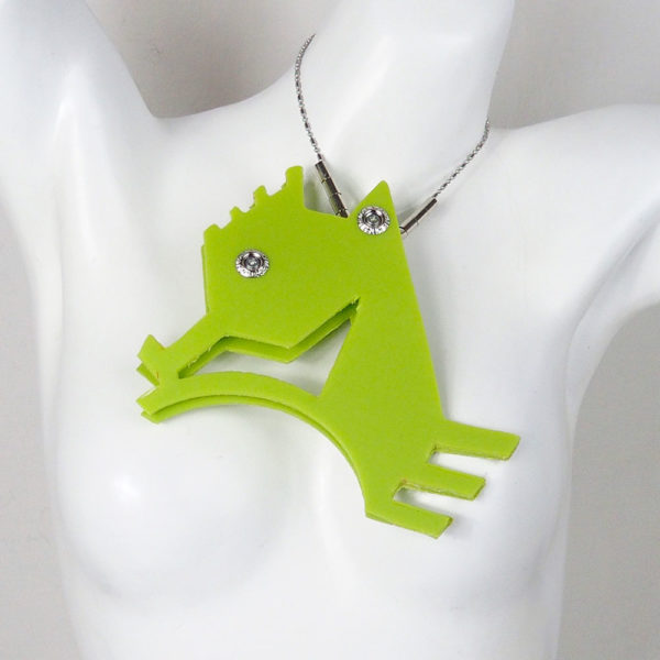large pendant necklace in the shape of a sea horse in neon colors statement necklace