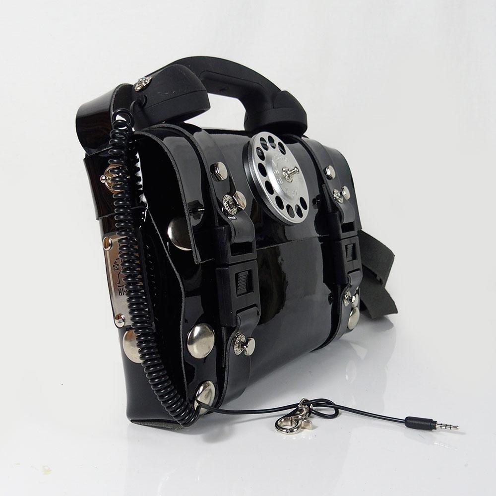 black shiny leather shoulder bag handbag with retro handle unusual statement bag