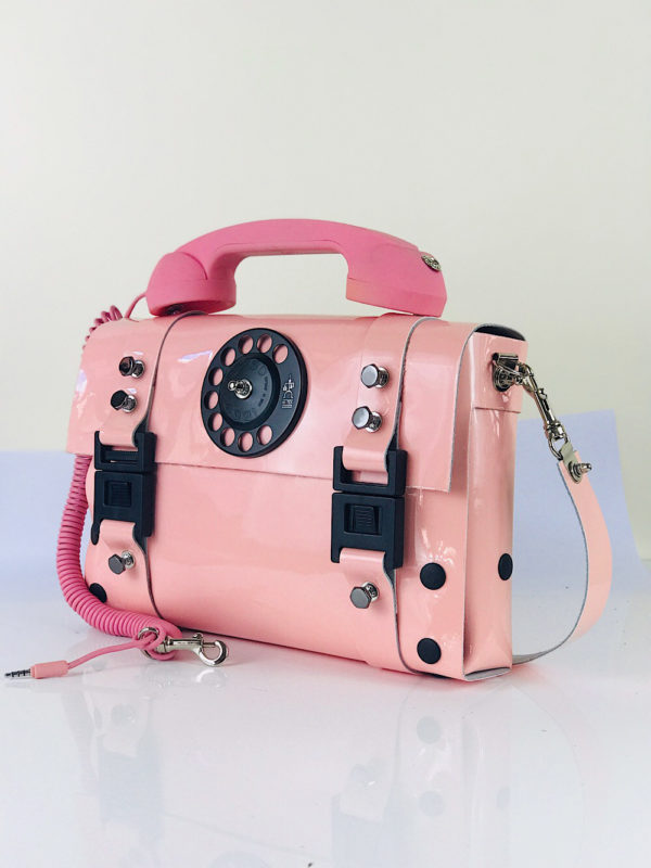 pink shiny leather shoulder bag unusual handle