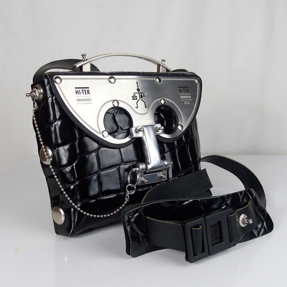 black shiny leather cross body bag, statement bag, futuristic, sci fi unusual unique