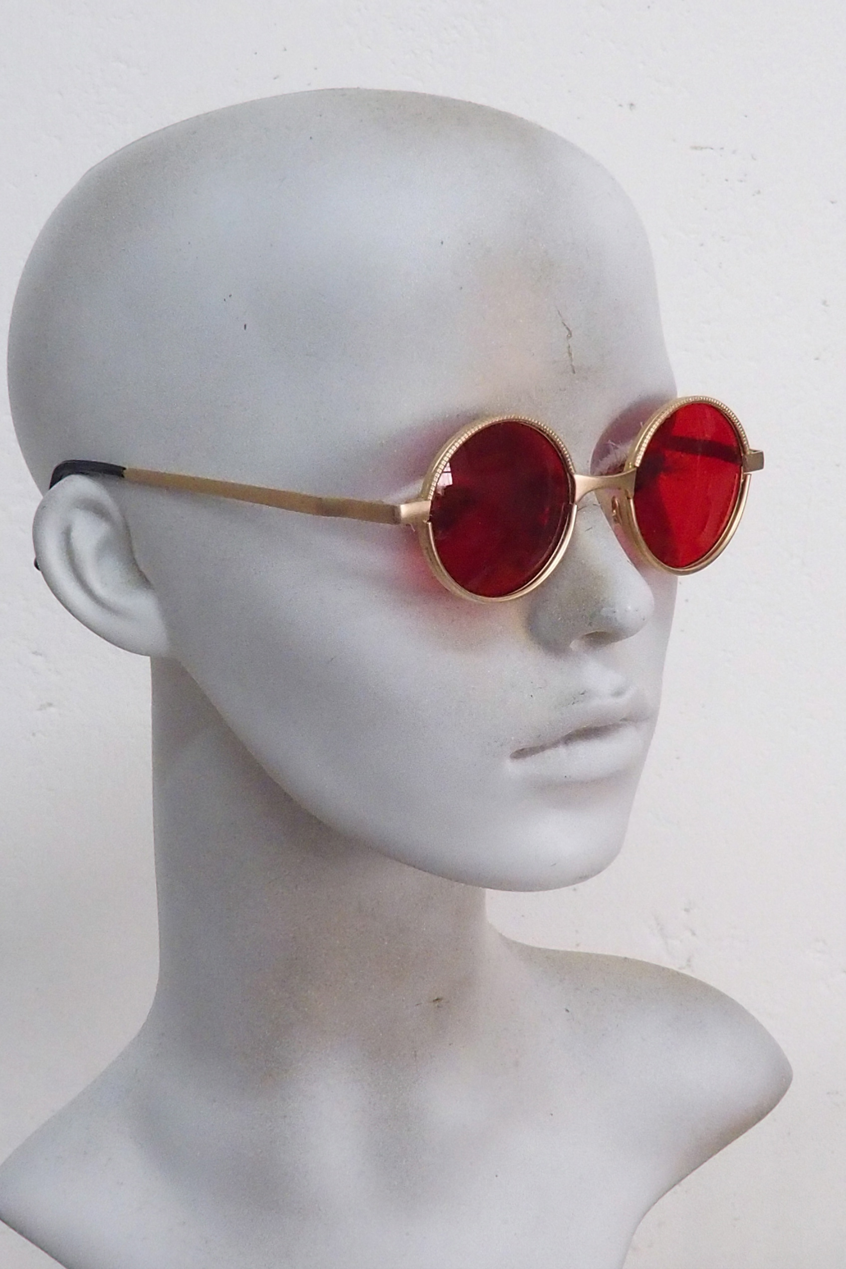 gold sunglasses red lens