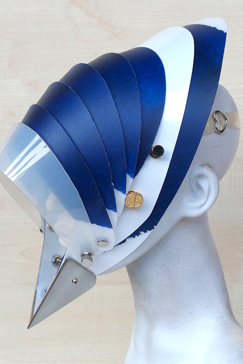 futuristic head wear in entertainment article, wearable art, cobalt blue white