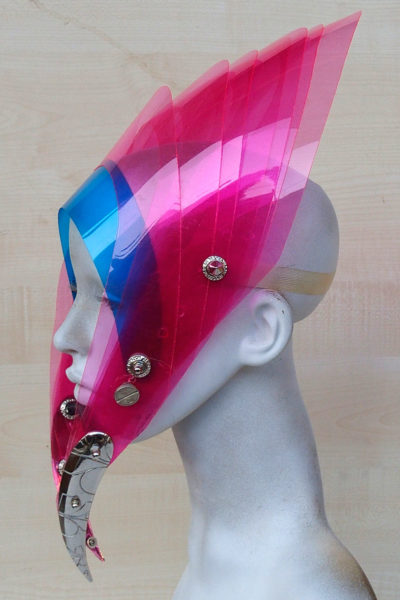 futuristic head wear with horns in entertainment article, wearable art, bright pink