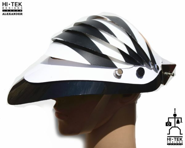 futuristic head wear in entertainment article, wearable art, cobalt black white stripe