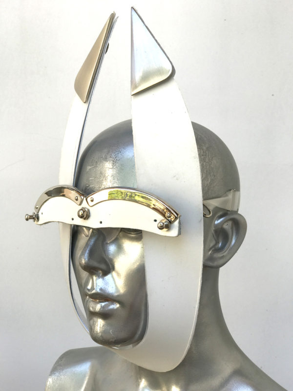 white mask with triangular horns metal components, styling video, Burning Man