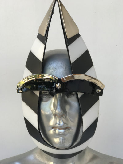 black and white stripe mask with triangular horns metal components, styling video, Burning Man