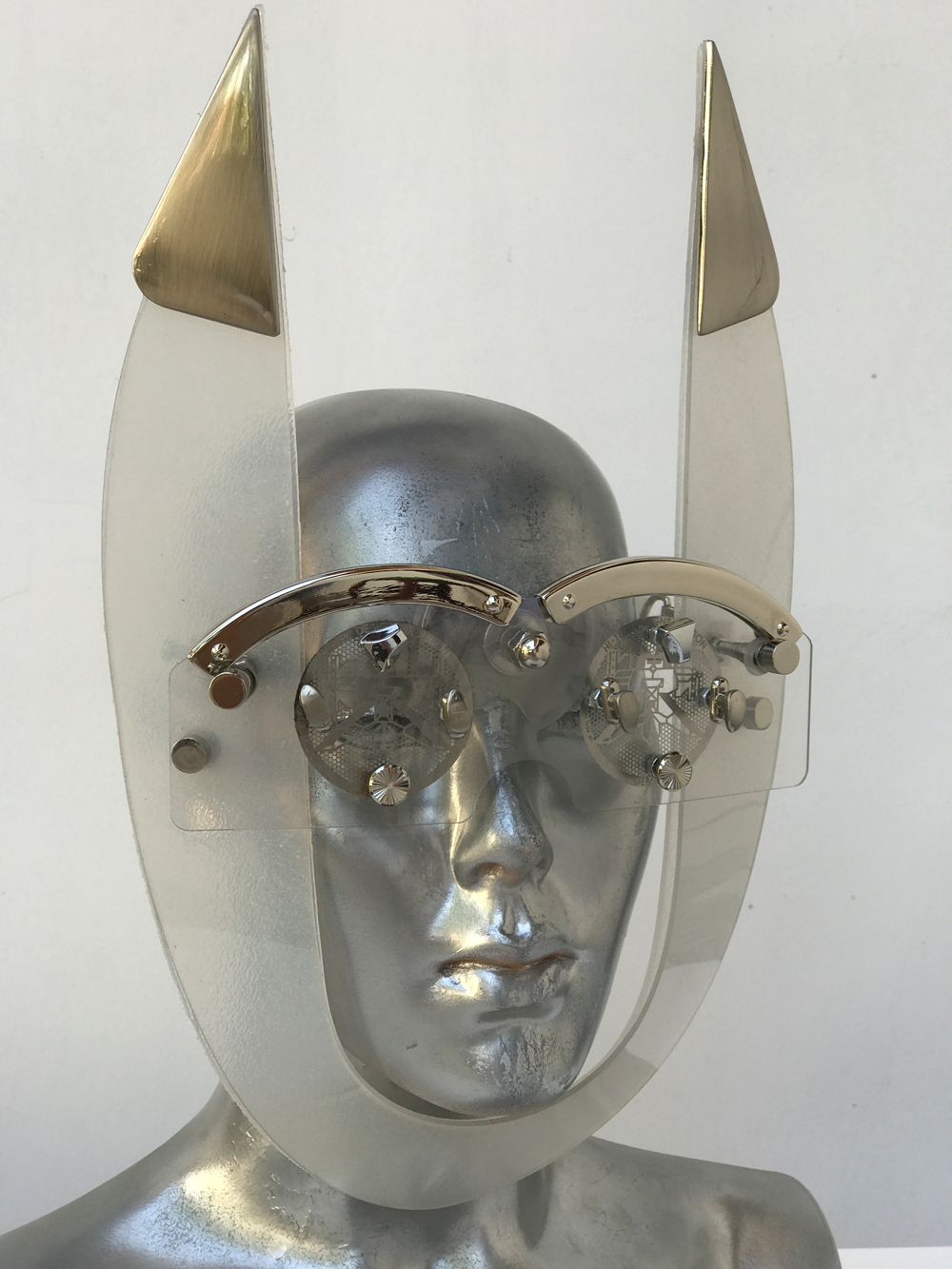 mask with horns perforated metal ocular lens metal components, styling video, Burning Man