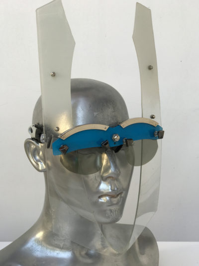 blue and white eye wear mask with horns and metal components, styling video, Burning Man