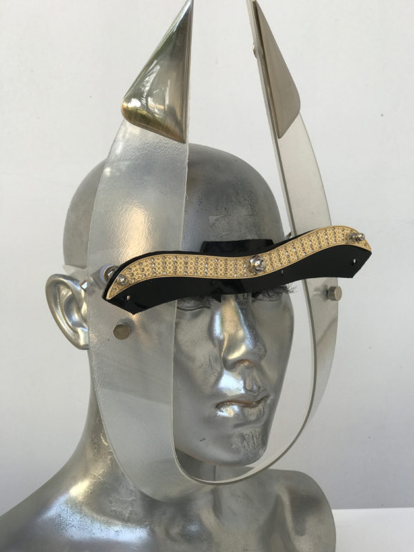 white eye wear mask with horns and metal components, styling video, Burning Man