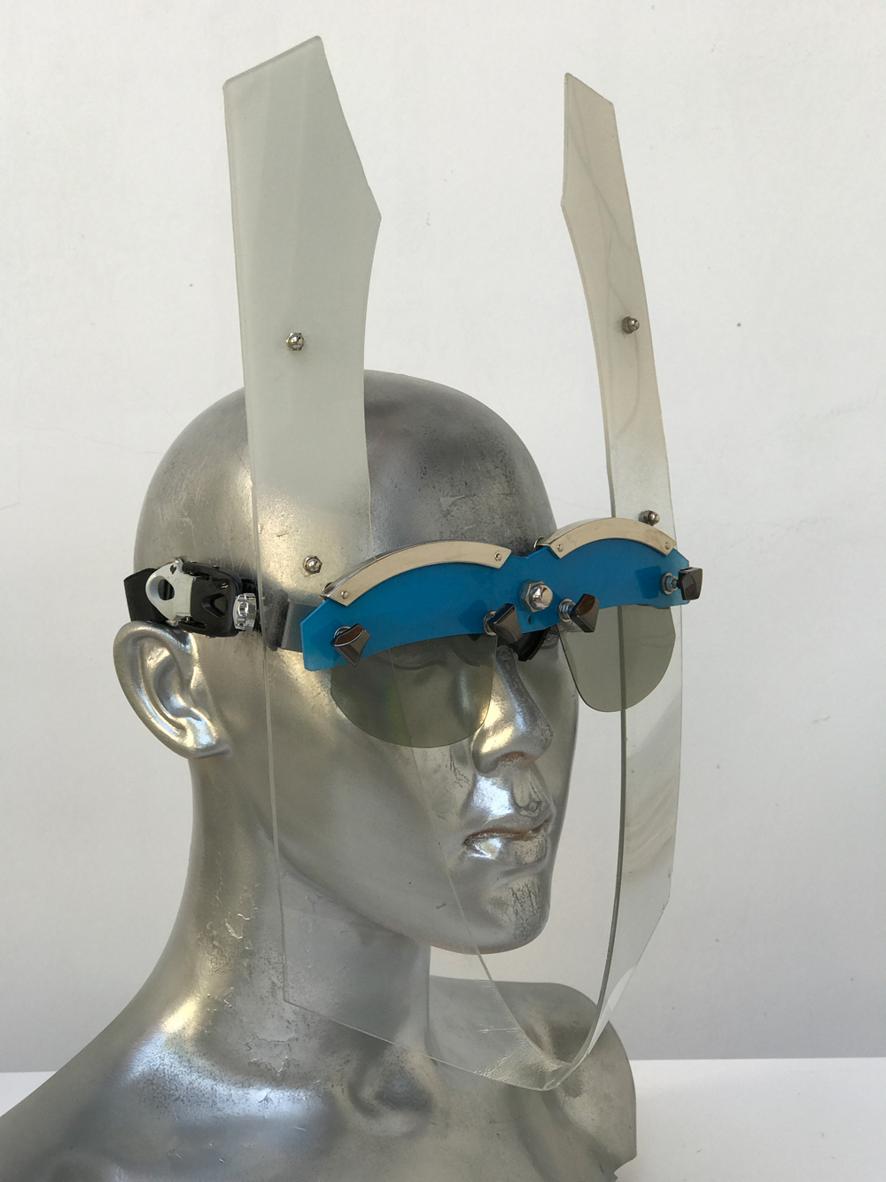 blue and white mask futuristic wearable art video styling Burning Man festival