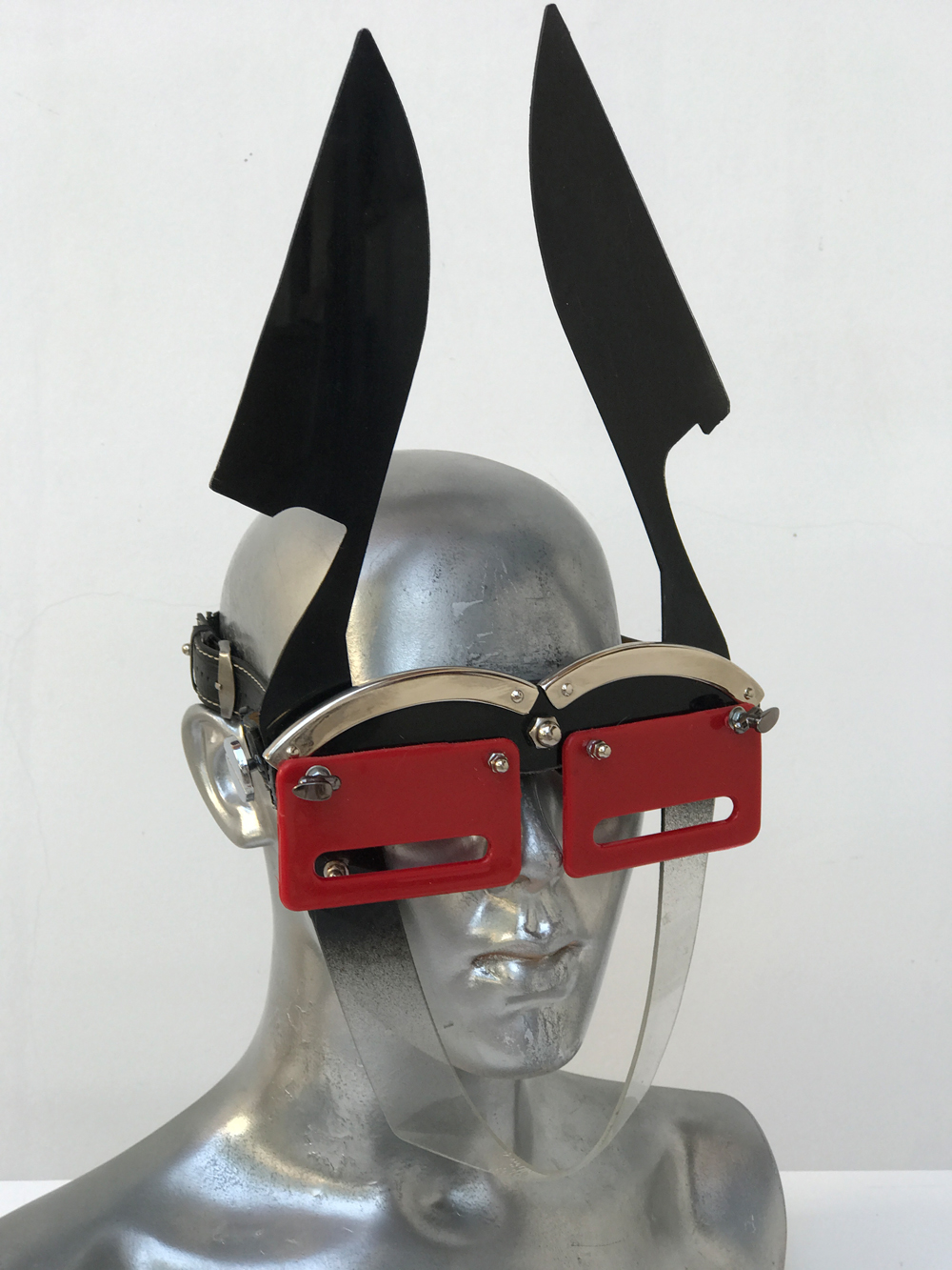 black and red mask with blade ears unusual eye wear styling, video, filming, performing Hi Tek