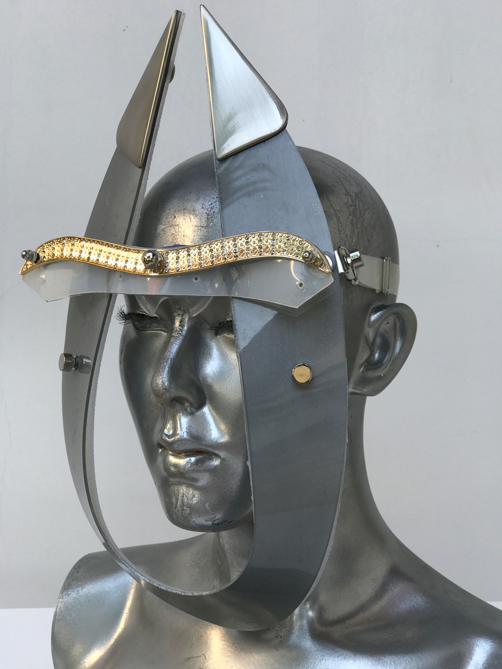 silver mask with horns and metal components, styling video, Burning Man
