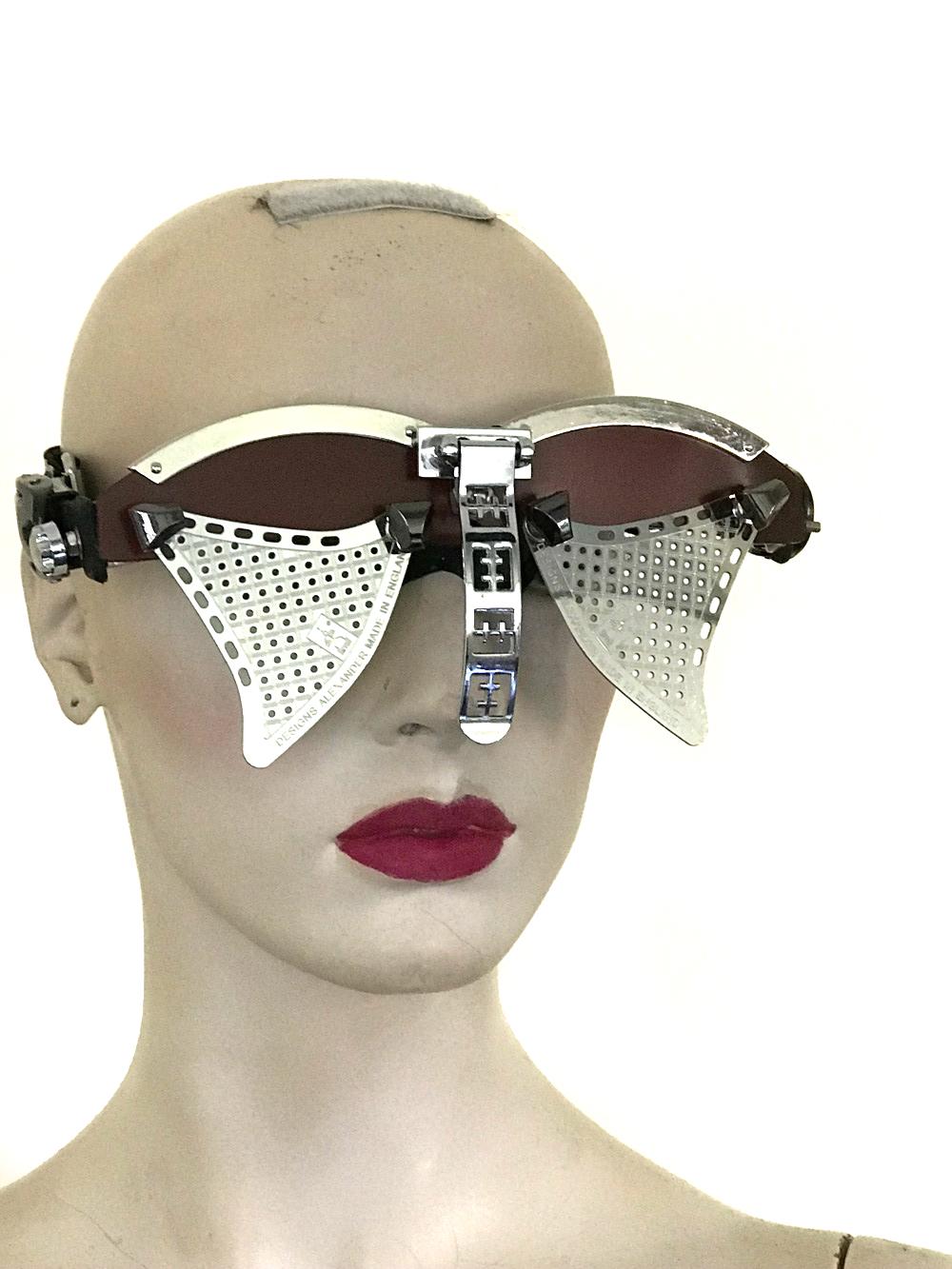handmade futuristic modern steampunk eyewear for artists Spartan nose shield metal lens burgundy face
