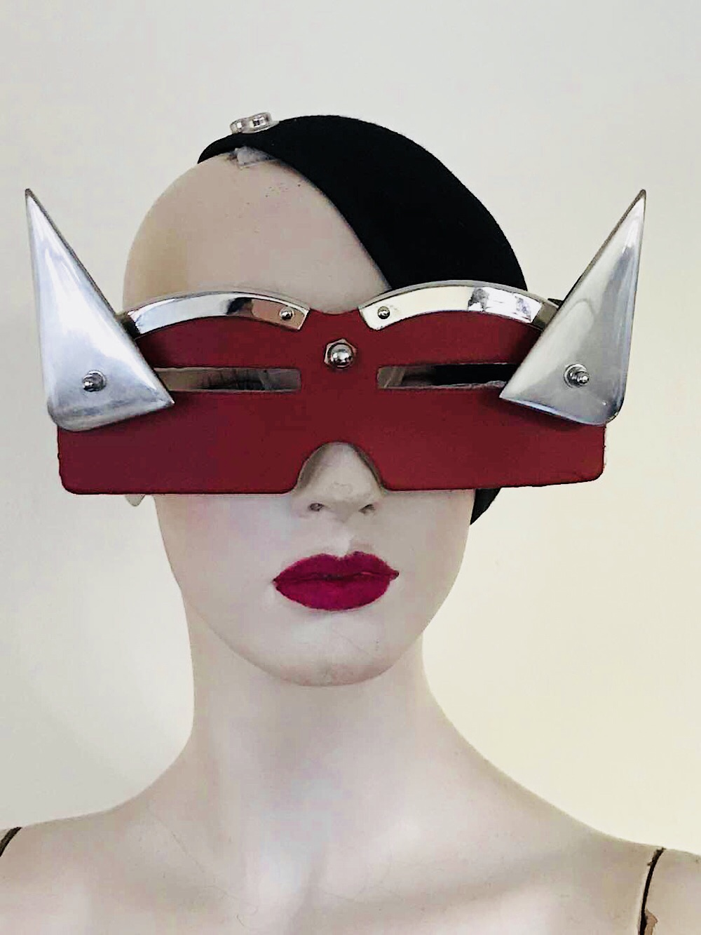 Artistic eye wear, red leather mask with metal triangular horns for filming theatre