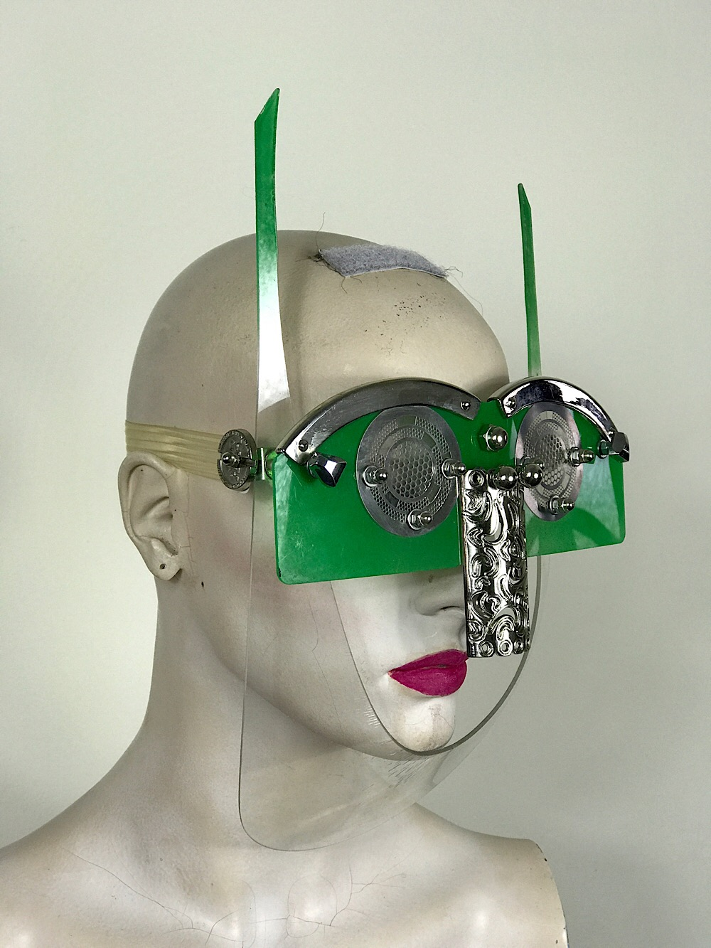 green  eyewear mask with horns metal nose shield perforated metal ocular lens Hi Tek