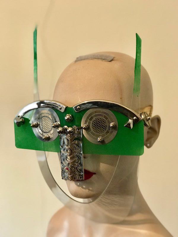 green  eyewear mask with horns metal nose shield perforated metal ocular lens Hi Tek